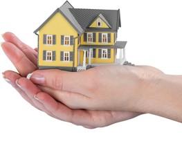 hand holding a miniature house model