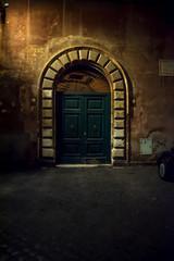 Old Roman Door of Home at Night