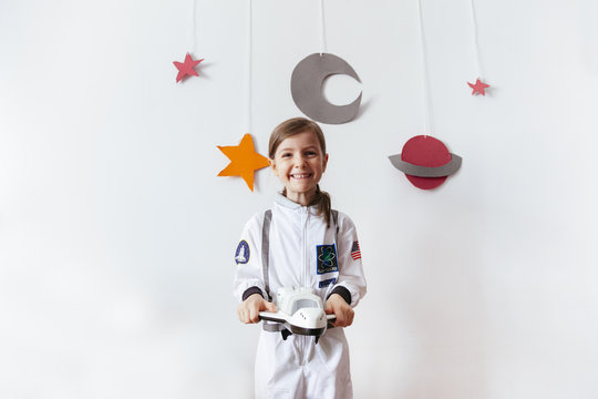 cheerful small kid became an astronaut