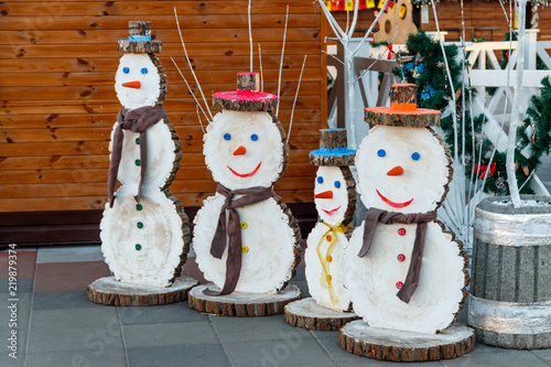 snowman made of wood in city park decoration for christmas and new years holidays