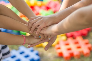 hands team spirit shake hold mixed men women help each other kids children playground game