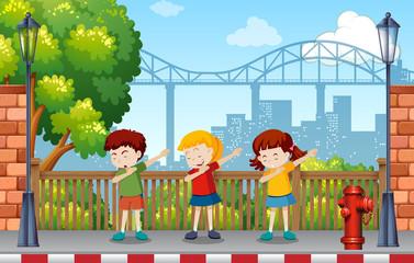 Children danceing in park
