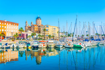 Marina in Saint Raphael dominated by church of our lady of the victory Fototapete