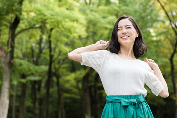attractive asian woman relaxing in park