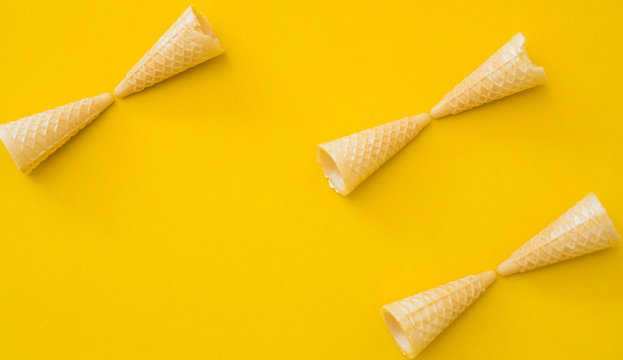 small Ice cream cone shape copyspace on yellow background