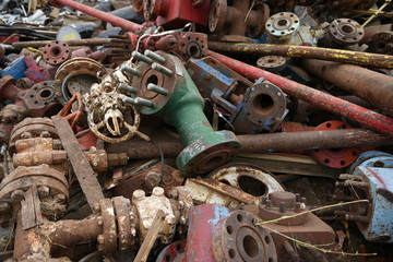 Large colorful pile of discarded industrial heavy scrap iron for scrap metal recycling.