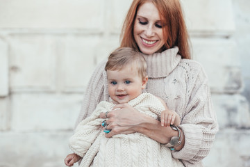Mom and baby dressed in warm winter knitted clothing