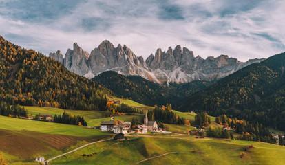 Foto auf Gartenposter Gebirge Santa Maddalena (St Magdalena) village with magical Dolomites mountains in background, Val di Funes valley, Trentino Alto Adige region, Italy, Europe