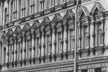 View of row of windows on an exterior of the medieval building in Saint Petersburg, Russia. Black and white photography.