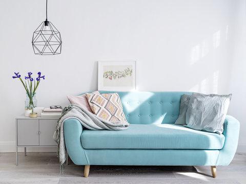 Bright blue sofa in stylish home interior