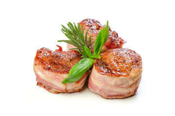 Pork fillet wrapped in bacon, isolated on white background.