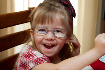 Young Girl With Thick Crooked Glasses for Strabismus
