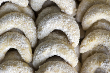 Traditional czech sweet Christmas cookies, vanilla rolls with white icing