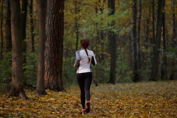 Photo from back in full growth of brunette running in forest