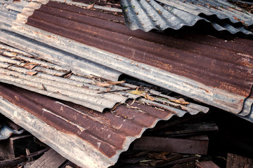 Pile of old wood and old zinc , selective focus and blur.