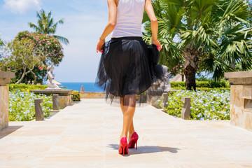 Woman wearing high heels and black skirt
