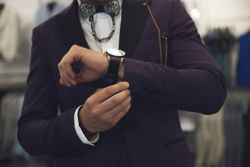 Men wearing a formal suit with accesories