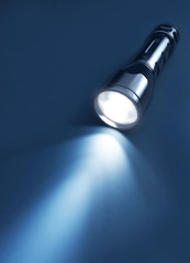 Flashlight and beam of light on a dark background. 3d rendering