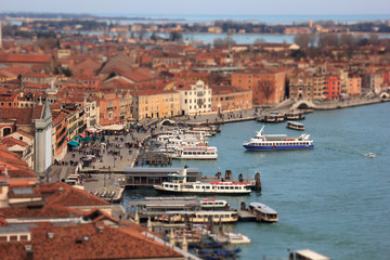 Grand Canal with boats and Basilica Santa Maria della Salute with tilt-shift effect. Venice, Italy.