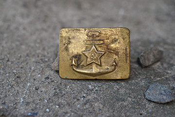 Buckle with the coat of arms of the Soviet Union navy fleet. Golden coat of arms of the USSR against the background of a grunge texture.