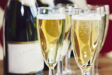 Bubbly champagne in glasses, with bottle
