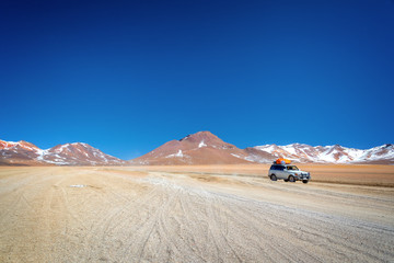 4x4 car on a road track in Sud Lipez Bolivia, adventure travel concept