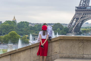 The lovers in Paris near the Eiffel Tower