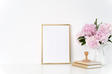 Gold portrait a4 poster mock up with a pink peonies in white jug, stamp. Overlay your quote, promotion, headline, or design, great for small businesses, lifestyle bloggers and social media campaigns