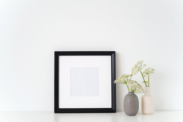 Black portrait square frame mock up with a episcopal weed in little vases grau and white. Mockup for quote, promotion, headline, design. Template for small businesses, lifestyle bloggers, social media