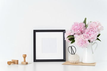 White portrait frame mock up with a pink peonies beside the frame, overlay your quote, promotion, headline