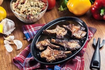 Roasted lamb chops on a roasting dish