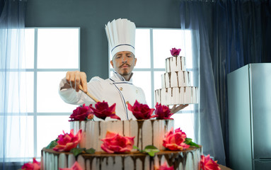 The cook makes a cake out of cream and chocolate