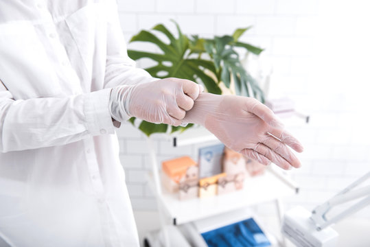 Protection above all. Close up of doctor hands in white latex gloves. Isolated on blurred background