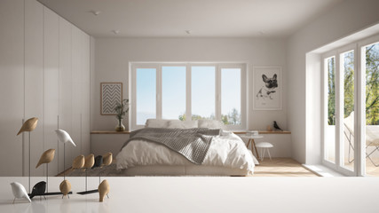 White table top or shelf with minimalistic bird ornament, birdie knick - knack over blurred contemporary bedroom with big windows, modern interior design