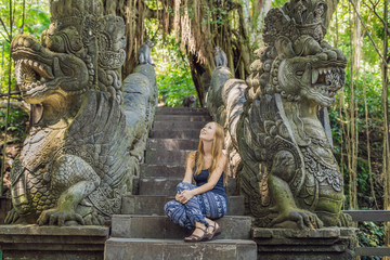 Young woman tourist explores the Monkey Forest in Ubud, Bali, Indonesia