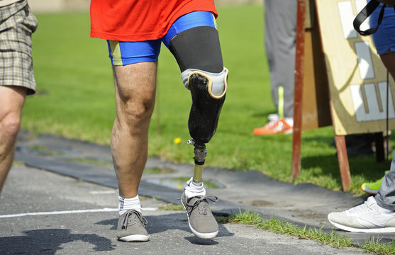 Disabled athlete with an artificial leg walking on a stadium. Trials among disabled Ukrainian soldiers to the 43 rd US Marine Corps marathon. July 20, 2018. Kiev, Ukraine