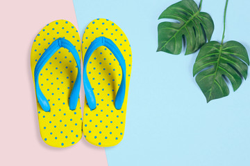 Yellow sandals with shell on blue color background, Summer holidays accessories . flat lay photo