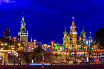 Poster Moscow Spasskaya Tower, Moscow Kremlin and Saint Basil s Cathedral at night in Moscow, Russia. Architecture and landmarks of Moscow. Postcard of Moscow