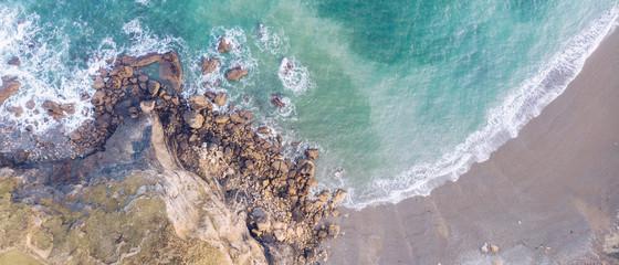 Waves near stony shore