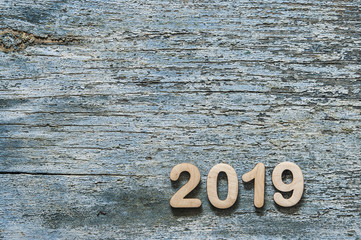 2019 Happy new year card on wood background. Blue wood.