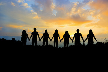 Group of people holding hands team unity