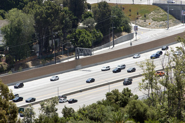 Bird's view of an highway and cars passing by in Los Angeles, California
