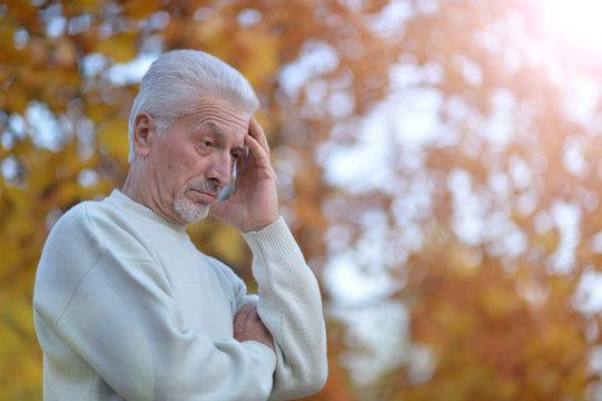 Portrait of a sad senior man outdoors