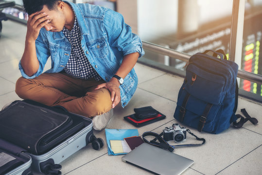 An Asian male traveler is experiencing the problem of need and lost value at the airport.