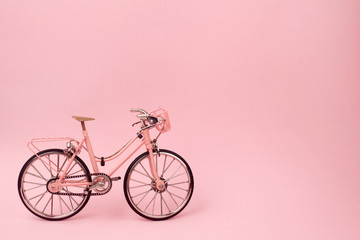 Aluminium Prints Bicycle Pink vintage bicycle on pink background. pastel minimal style concept.