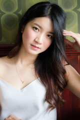 Portrait of thai china adult beautiful girl White shirt blue jeans relax and smile