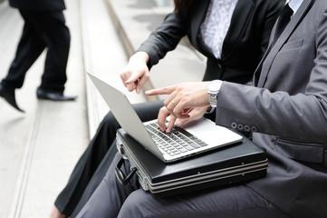 Business adviser analyzing financial figures denoting the progress Field work outdoor