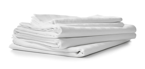 Fototapeta Stack of clean bed sheets on white background