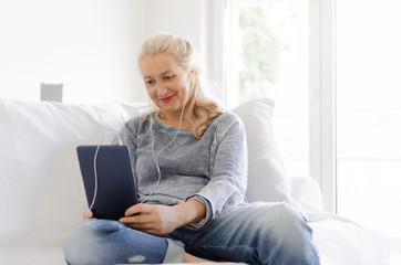 Woman sitting and holding tablet