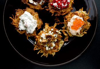Hanukkah, Latkes with Greek Yogurt and Pomegranate Seeds, with Smoked salmon cream cheese with salmon roe, Crumbled gorgonzola with brandied figs, Smoked trout spread, Crme Fraiche and Pear butter